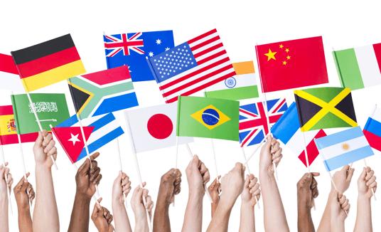 Hands waving international flags