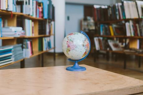 photo-of-globe-on-wooden-table-3747527